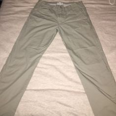 Men's Calvin Klein Khakis Never worn very pale tan khaki color. Calvin Klein Calvin Klein Pants Trousers
