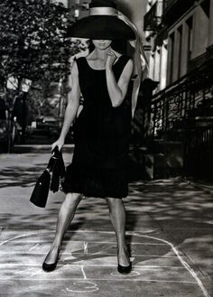 Elegant hopscotch during the filming of Breakfast Tiffany's, 1961.