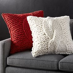 Shop Cable Knit Pillow with Feather-Down Insert. Cozy up to our striking, sweater-like pillow, hand knitted of chunky wool-blend yarn in an oversized cable pattern. Layer with our selection of neutral, textured pillows for a chic monochrome look. Knitted Cushion Pattern, Knitted Cushions, Knitted Blankets, Red Pillows, Throw Pillows, Pillow Texture, Crochet Pillow, Blanket Crochet, Crochet Granny