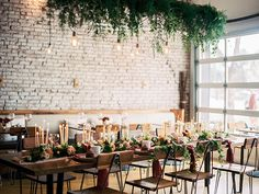 Rustic Industrial Reception with a Candle Runner and Greenery Chandelier | Michele Hart Photography | http://heyweddinglady.com/mid-century-minimalist-winter-wedding-styling/