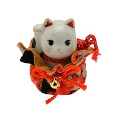 Maneki Neko with Gold Pouch.  In Japan, his name basically means Good Luck Cat.  Its creation honors a real cat that brought good fortune to his impoverished master centuries ago. Its reminiscent of the old European tale of Puss in Boots.