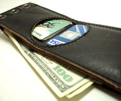 Leather wallet. via Etsy. nice slide in for cards, not sure yet about studs