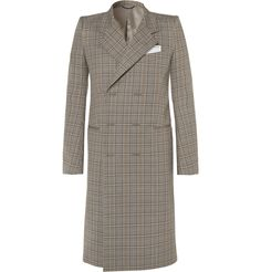Balenciaga's boxy coat typifies the latest collection's unorthodox approach to structure. Crafted in Italy from hardy cotton, the checked style has strong padded shoulders and discreet welt pockets, as well as a concealed double-breasted fastening that will keep out chills. It's fully lined in smooth sa...