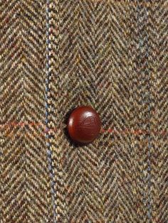 """Leather Harris Tweed """"Orb"""" button on a superb Mario Barutti Harris Tweed jacket currently for sale on our website."""
