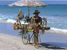 """Varadero beach vendor. We used to buy """"pirulis"""" (conical lollipops) and """"mamoncillos"""" (tropical fruit)."""