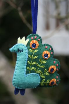 Peacock Ornament One of my first inspirations to make felt ornaments was Chikagraphy. I saw her creations at Anthropology and loved them. She doesn't have much of a web gallery but I studied what made her wor… Felt Christmas Ornaments, Handmade Christmas, Christmas Crafts, Peacock Ornaments, Art Textile, Felt Birds, Felt Patterns, Ornament Crafts, Felt Fabric