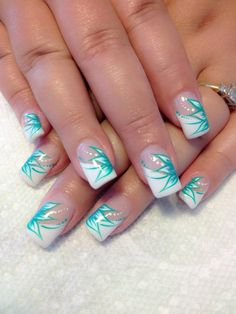 White tips with blue flower design nails