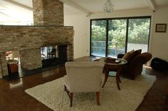 The dining room also is a nice salon; it's nice to sit by the fire on both sides of the fire place. Contemporary Architecture, Modern Contemporary, Mad Men, Corner Desk, Dining Room, Fire, Places, Furniture, Design