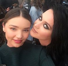 Let me take a selfie!Miranda Kerr (left) has been pictured for the first time with pop star Katy Perry (right), the new girlfriend of her ex-husband Orlando Bloom, at the Moschino Fashion Show in Los Angeles on Friday