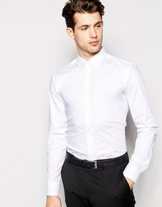 """Shirt by Hugo Boss Soft-touch, crisp poplin Contains stretch for comfort Point collar Button placket Slim fit - cut closely to the body Machine wash 97% Cotton, 3% Elastane Our model wears a size Medium and is 188cm/6'2"""" tall"""