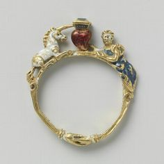 Ring of gold, enamel and diamonds. In the center a heart topped by a diamond between a white unicorn and a woman dressed in blue.  dated 1550-1600
