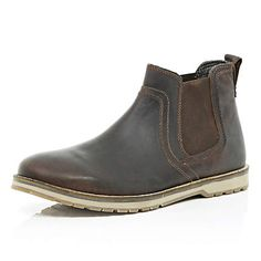 Dark brown cleated sole Chelsea boots.