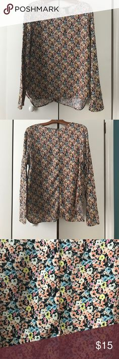 Floral long sleeved top. Floral long sleeve top with buttons down the back. Super comfy. Size 14 H&M Tops Blouses