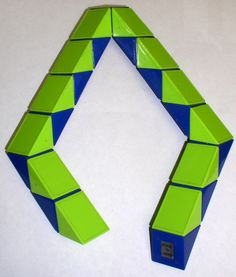 Rubik's Snake.. still have one! my bro was always able to put it together, but I never could.