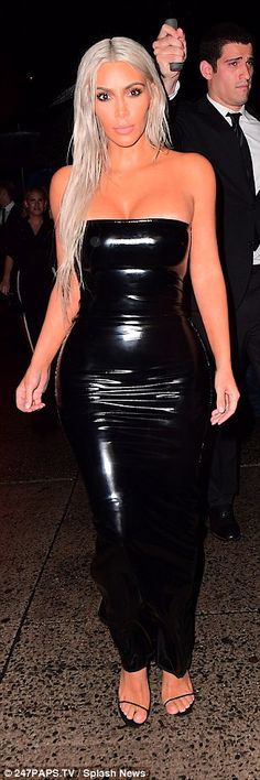 Heading in:Kim completed her sultry look with her go-to choice in heels - strappy black stilettos