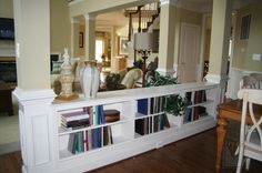 I would love to replace the railing that is between the family room and kitchen with a built in like this