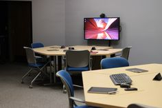 The Flipped Plus Plus classrooms -- room 312 and 315 -- in The Pyle Center feature three pods with movable furniture, 40 inch LCD monitors at each pod for learners to share their work, a 70 inch monitor which allows instructors to share work or work from learners devices, desktop video conference capabilities, and an iPad cart for learners to share their work. It also supports learners who bring their own devices.