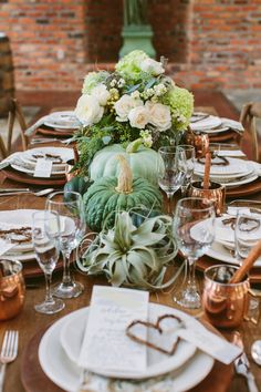 green tablescape with pumpkins, photo by Ashleigh Jayne Photography http://ruffledblog.com/green-autumn-wedding-inspiration #weddingideas #reception #tablescapes
