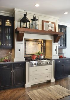 black and cream craftsman kitchen cabinets with wood beam mantle