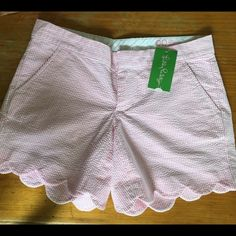 1 DAY SALENWT Lilly Buttercup Shorts NWT Pink and White skinny striped Lilly Pultizer size 00 shorts. These are super cute and have a scalloped hem! These could easily fit a size 0! They run a little bigger. Lilly Pulitzer Shorts