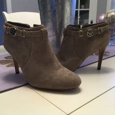 COACH Suede Shoe Boots. Size 7.5 Beautiful Suede COACH Shoe Boots. Size 7.5. Buff/Gray. These shoe boots are so pretty, has Coach Silver jewelry and suede buckles at ankle. Side zippers and wooden heels add extra fashion to these lovely boots. Boots were worn once and have scuff marks and exposed price tag from TJ maxx on the bottoms. Coach Shoes Ankle Boots & Booties