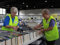 Lifeline Canberra volunteers Joy Nicholls and Ashley Haycraft sort books before the first book fair of the year. (Image: ABC/Louise Maher)