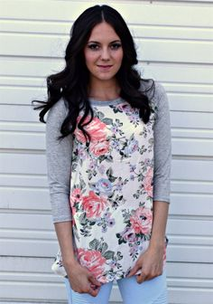 Floral Baseball Tunic. Soft and flowy and perfect for summer! 100% Rayon (body) and 95% Rayon and 5% Spandex (sleeves).