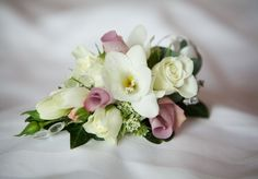 Mother of the Bride freesia and spray rose corsage