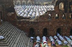 Muslims offer prayers at the ruins of the Feroz Shah Kotla mosque in New Delhi.