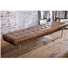 Tufted gallery bench in vintage cigar brown leather by Regina Andrew Design.