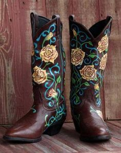 Hand painted design by A Benoit: We have moved into our new store and have more than 750 pair of used western cowboy and cowgirl boots...  We are now offering a full line of western belts,