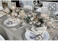 11 stunning Christmas dining decoration ideas 2018 that will make all the family member impress and happy on the dinner time. Christmas Dining Table, Christmas Table Settings, Christmas Tablescapes, Christmas Table Decorations, Decoration Table, Holiday Decor, Silver Centerpiece, Silver Christmas Decorations, Centerpiece Ideas