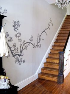 I love this cherry-blossom mural that starts in the entry and then puts feelers up the stairs!
