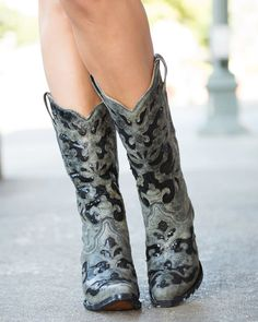 You'll turn heads when you put on these charcoal-colored western fashion boots with sequins from Corral. The boots come with black inlays and glittering black sequins throughout, along with a snip toe and fashion heel. Corral has long been known for its cutting-edge looks, and this is no exception.<BR><br>Corral cowgirl boots are made with western fashion details, top grade leathers, and first class quality. Corral boots are handcrafted and hand-finished by the the most experienced boot…