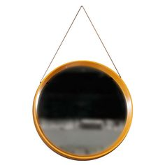 Yellow-Orange Danish Round Mirror with Leather Cord | From a unique collection…