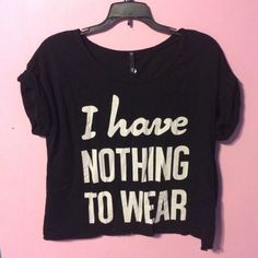 """I am selling a cotton crop top. This loose shirt is black with white letters that say, """"I have nothing to wear"""" on the front and has short, cuffed sleeves. I have washed this shirt, but I have not actually worn it somewhere. Love Culture Tops Crop Tops"""