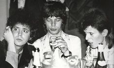 Lou Reed, Mick Jagger, and David Bowie hanging out at Cafe Royal in London, 1973.