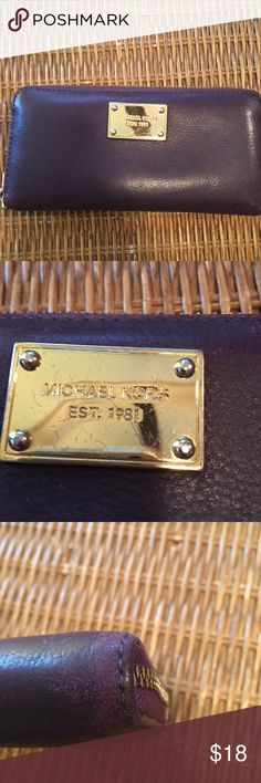 Gently Used Michael Kors Wallet Gently Used Michael Kors Wallet. Super pretty dark purple color. Wallet does exhibit signs of wear (see pictures for wear). 8 cars slots with middle zipper for change. 2 pockets on either side of wallet. Gold hardware Michael Kors Bags Wallets