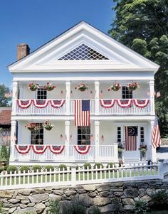 American flags and banners adorn the front of this Federal-era All-American beauty, which underwent extensive renovation.