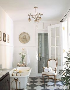 50 Great Bathrooms.  Love the french doors.