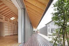 house-with-exposed-timber-rafters-bookshelf-columns-3-porch.jpg