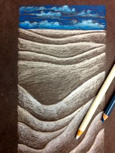 Value Landscape-Students choose one neutral color and one warm or cool color for the sky. Lines are sketched across the page (top line/horizon line) and with the chosen prismacolors, value and shading become the focus of the drawing lesson.