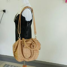 """{Steve Madden} Tan Studded Convertible Handbag Steve Madden Tan Studded Convertible Handbag. Adjustable Crossbody As Well As Shoulder Bag. GOOD USED CONDITION.   2 Pockets  1 Zipper Pocket >MEASUREMENTS  Length :16"""" Height :11"""" Width:5 1/2"""" Strap Drop: 17"""" Handle Drop: 10""""  Please Ask Questions Before Purchasing  ALL SALES ARE FINAL   NO TRADES NO PAYPAL NO HOLDS NO LOW BALL OFFERS Steve Madden Bags Crossbody Bags"""