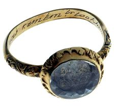 """Woman's """"memorial poesy ring"""" from 1592, made of gold and rock crystal, inscribed on its inner surface: """"The cruel seas, remember, took him in November.""""      From the exhibition at the Folger in Washington of old England's relationship with the sea."""