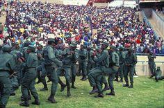MK(Umkhonto-We-Sizwe) soldiers toyi-toyi at Chris Hani's funeral, Soweto, 1993.