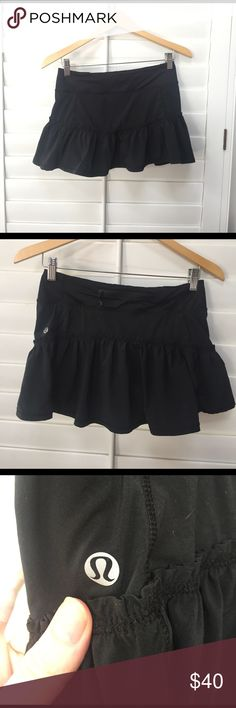 Lululemon skirt Black lululemon mini skirt with shorts underneath. Size 4. Has zipper pocket on waist in back and can cinch up around the waist. Excellent condition, only worn a few times. lululemon athletica Skirts Mini