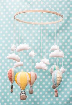 Up, up and away! This balloon mobile is seriously simple to DIY, and check out that panda! Great project when you're pregnant & getting baby's nursery ready.