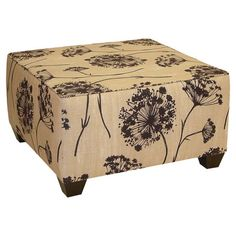 Lend a pop of pattern to your living room or parlor with this chic cocktail ottoman, showcasing floral-print upholstery and a pine wood frame. Handmade the U...