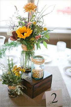wildflower sunflower wedding centerpieces / http://www.himisspuff.com/country-sunflower-wedding-ideas/6/