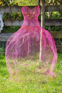 How fun! Let's have a Ball in the garden. Plant something frothy at the hem, and bing plants to climb the skirt